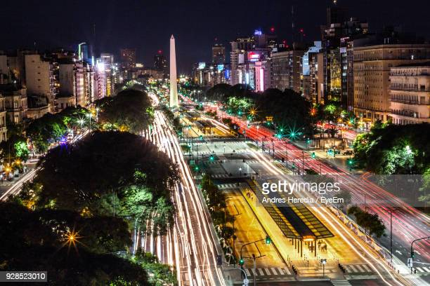 high angle view of light trails on road along buildings - buenos aires stock pictures, royalty-free photos & images