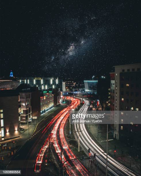 high angle view of light trails on road at night - bristol england stock pictures, royalty-free photos & images