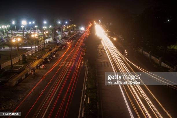 high angle view of light trails on road at night - central kalimantan stock pictures, royalty-free photos & images