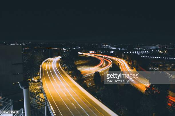 high angle view of light trails on road at night - anaheim californië stockfoto's en -beelden
