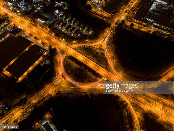 high angle view of light trails on road at night - shah alam stock photos and pictures