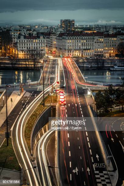 high angle view of light trails on road at night - lyon photos et images de collection