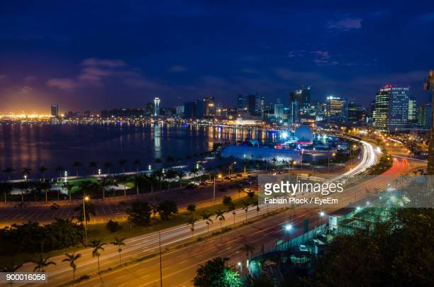 high angle view of light trails on road in city at night - angola stock pictures, royalty-free photos & images