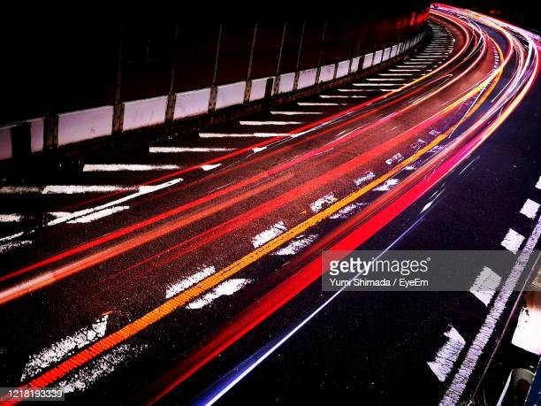 high angle view of light trails on road - sports track stock pictures, royalty-free photos & images