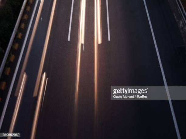 high angle view of light trails on road - oppie muharti stock pictures, royalty-free photos & images