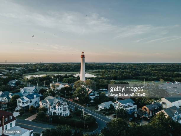 high angle view of lighthouse and buildings against sky. cape may new jersey lighthouse - new jersey stock pictures, royalty-free photos & images