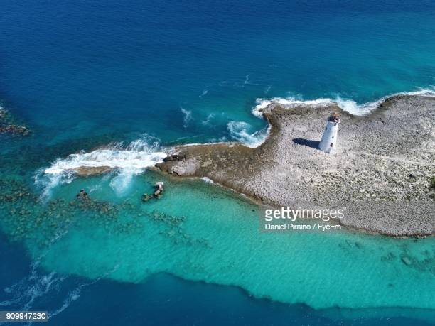 high angle view of lighthouse by sea - nassau stock photos and pictures