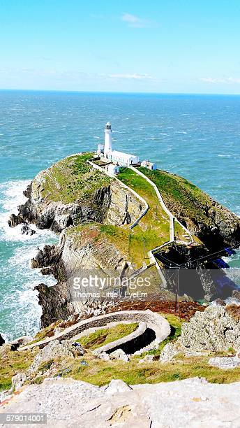 High Angle View Of Lighthouse On Shore
