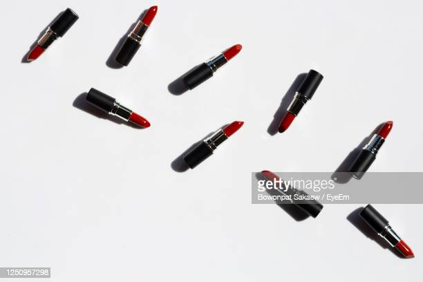 high angle view of lipsticks on white background - matte lips stock pictures, royalty-free photos & images
