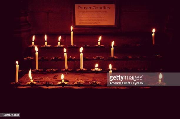 High Angle View Of Lit Candles In Church