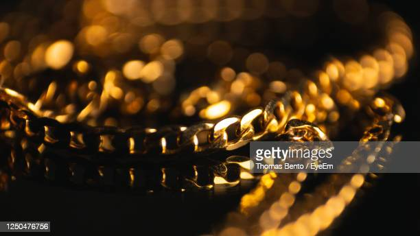 high angle view of lit candles on table - gold chain necklace stock pictures, royalty-free photos & images
