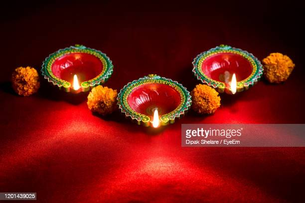 high angle view of lit diyas on two tone background - diwali decoration stock pictures, royalty-free photos & images