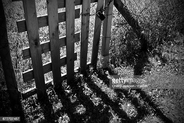 High Angle View Of Locked Wooden Gate On Field