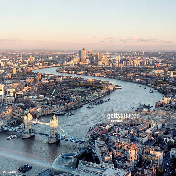 high angle view of london skyline at sunset - canary wharf stock photos and pictures