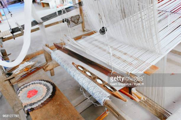 High Angle View Of Loom At Textile Industry