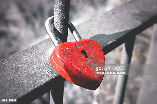 High Angle View Of Love Padlock Attached To Railing