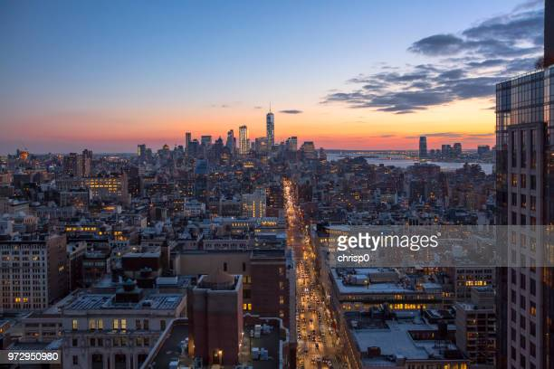 high angle view of lower manhattan at dusk - sixth avenue stock pictures, royalty-free photos & images