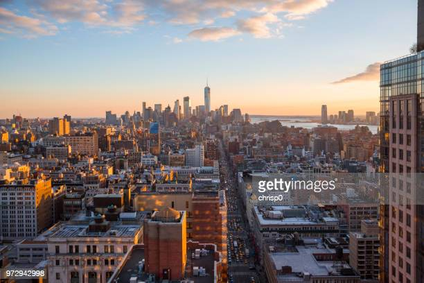 high angle view of lower manhattan at sunset - chelsea new york stock pictures, royalty-free photos & images