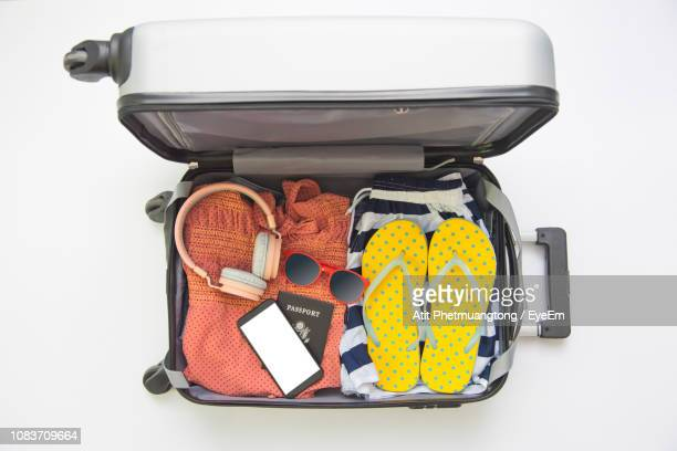 high angle view of luggage in suitcase against white background - vêtement pour femmes photos et images de collection
