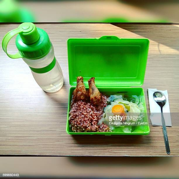 High Angle View Of Lunch Box And Water Bottle On Table