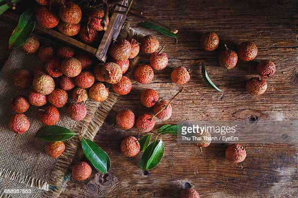 High Angle View Of Lychees On Wooden Table