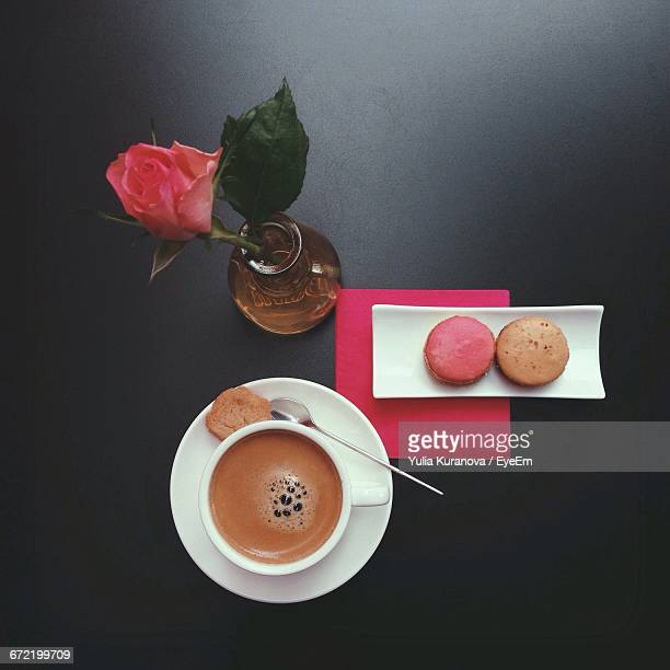 High Angle View Of Macaroons And Coffee Cup On Table