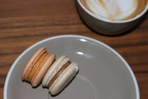 High angle view of macaroons in plate on table