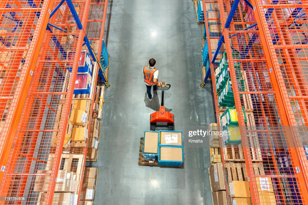 High angle view of Male warehouse worker. : Stock Photo