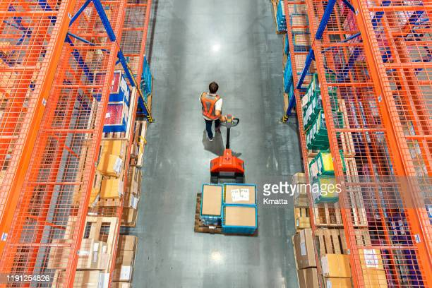 high angle view of male warehouse worker. - 倉庫 ストックフォトと画像