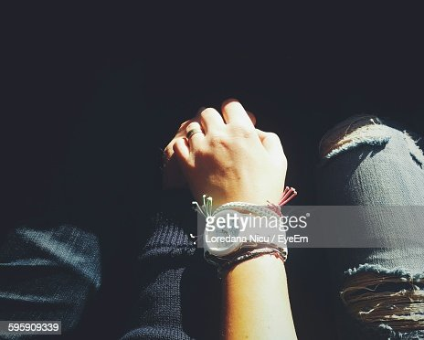 High Angle View Of Man And Woman Holding Hands While Sitting Outdoors
