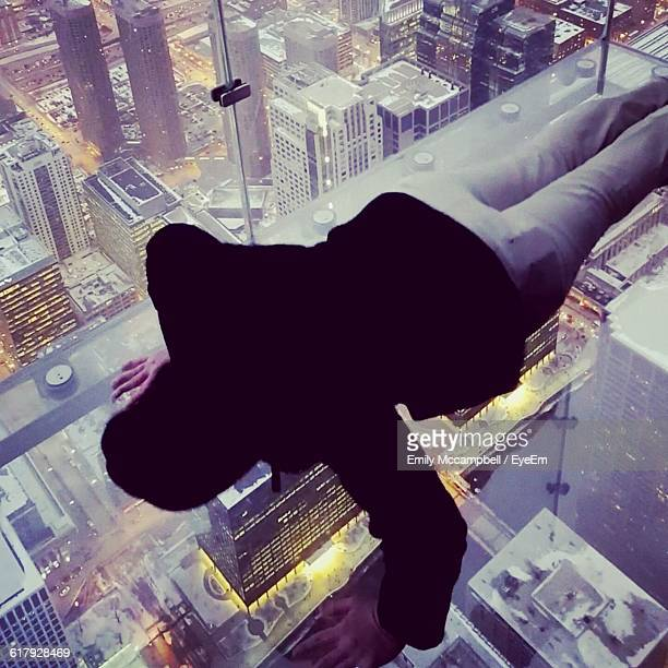 High Angle View Of Man Doing Push-Ups On Glass At Skydeck Chicago