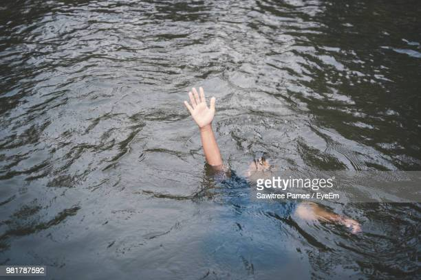 High Angle View Of Man Drowning In Lake