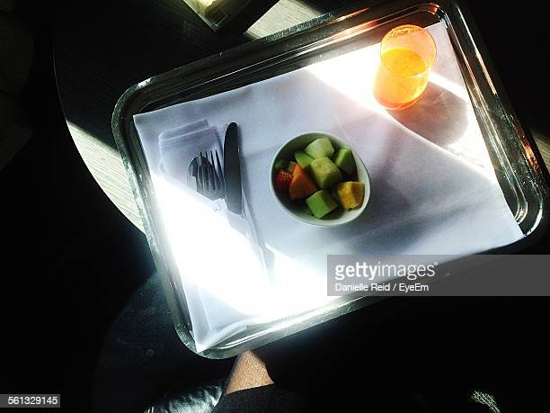 high angle view of man holding breakfast in tray - danielle reid stock pictures, royalty-free photos & images