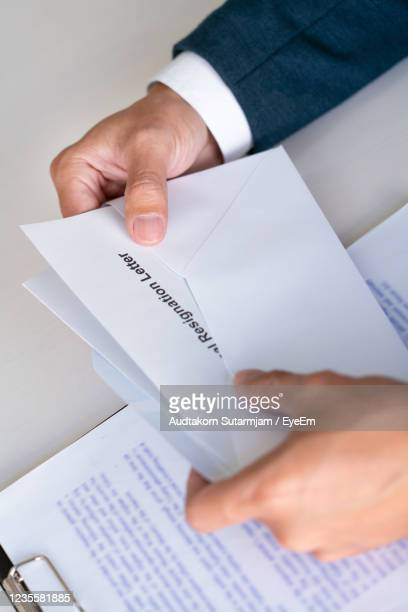 high angle view of man holding paper - dismissal cricket stock pictures, royalty-free photos & images