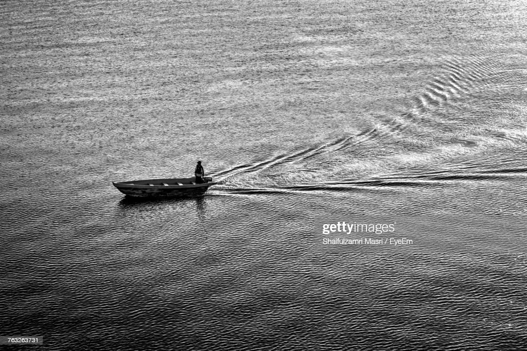 High Angle View Of Man In Boat Sailing On Sea : Stock Photo