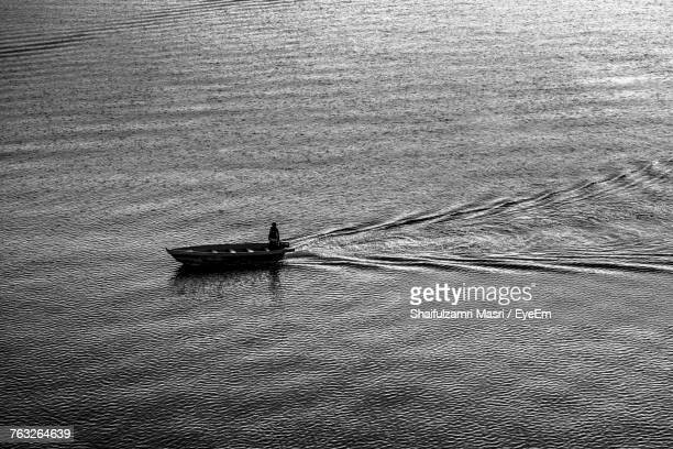 High Angle View Of Man In Boat Sailing On Sea