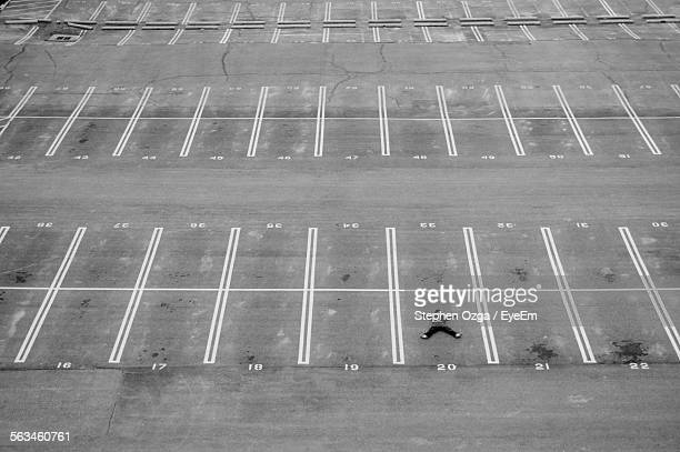 High Angle View Of Man In Parking Lot