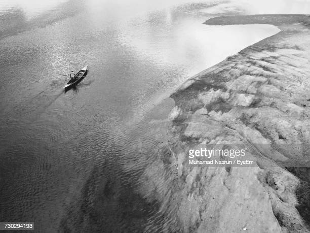 high angle view of man in sea - muhamad nasrun stock pictures, royalty-free photos & images