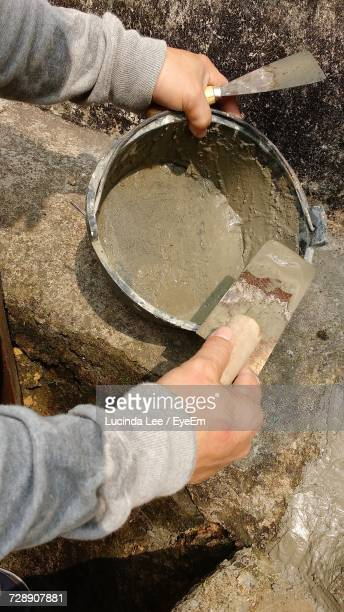 high angle view of man laying cement - lucinda lee stock photos and pictures