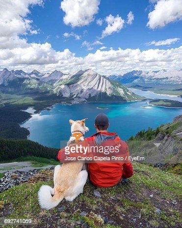 High Angle View Of Man Looking At Snowcapped Mountain