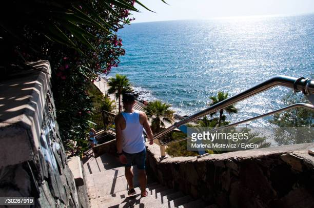 High Angle View Of Man Moving Down From Steps At Gran Canaria Island