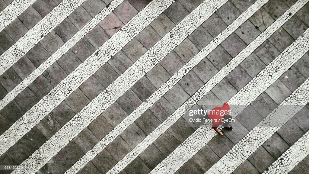 High Angle View Of Man Moving Up On Steps : Stock Photo