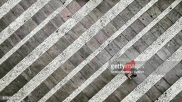 high angle view of man moving up on steps - steps stock photos and pictures