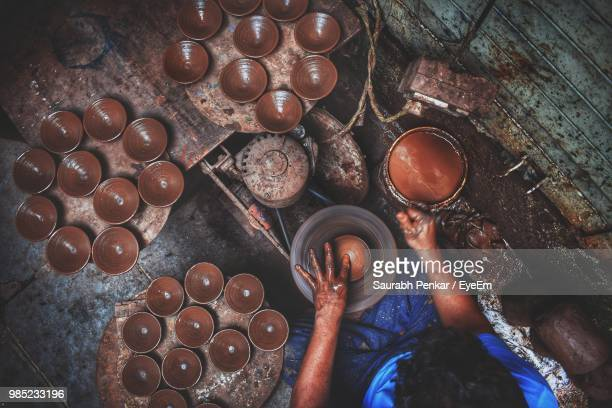 High Angle View Of Man Preparing Clay Bowl