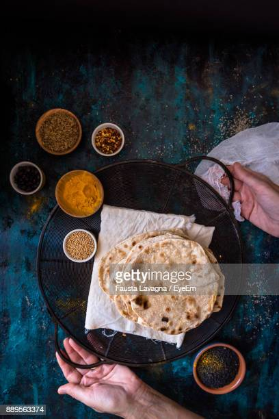 high angle view of man preparing food - indian food stock pictures, royalty-free photos & images