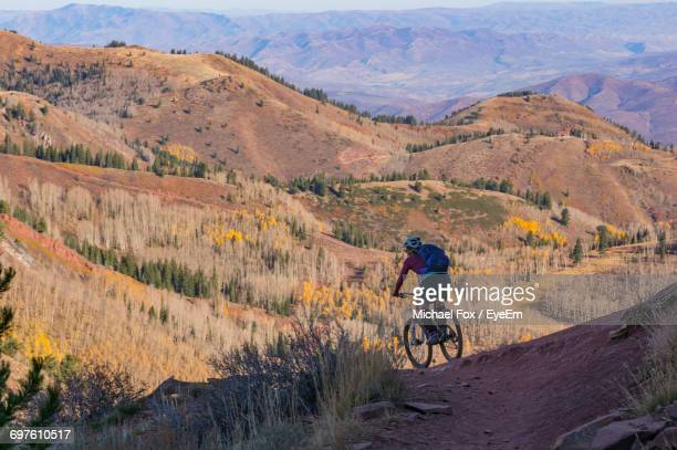 High Angle View Of Man Riding Bicycle On Mountain