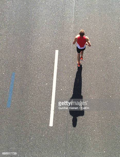 High Angle View Of Man Running On Road