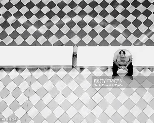 High Angle View Of Man Sitting On Bench