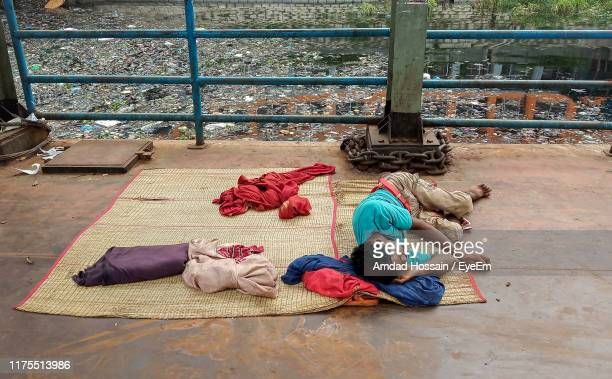 high angle view of man sleeping on carpet - amdad hossain stock pictures, royalty-free photos & images