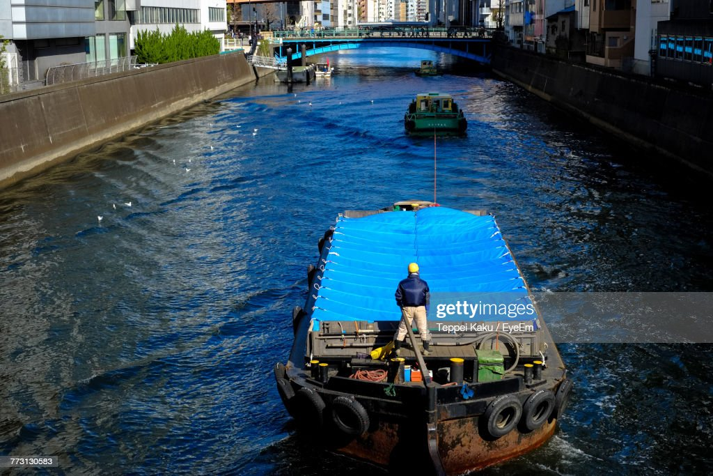 High Angle View Of Man Standing In Ship On Canal : Photo